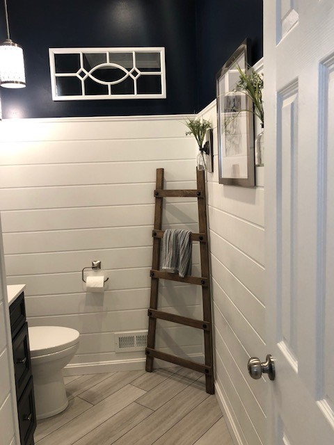Shiplap and Navy Paint Powder Room with Some Homey Unique Elements