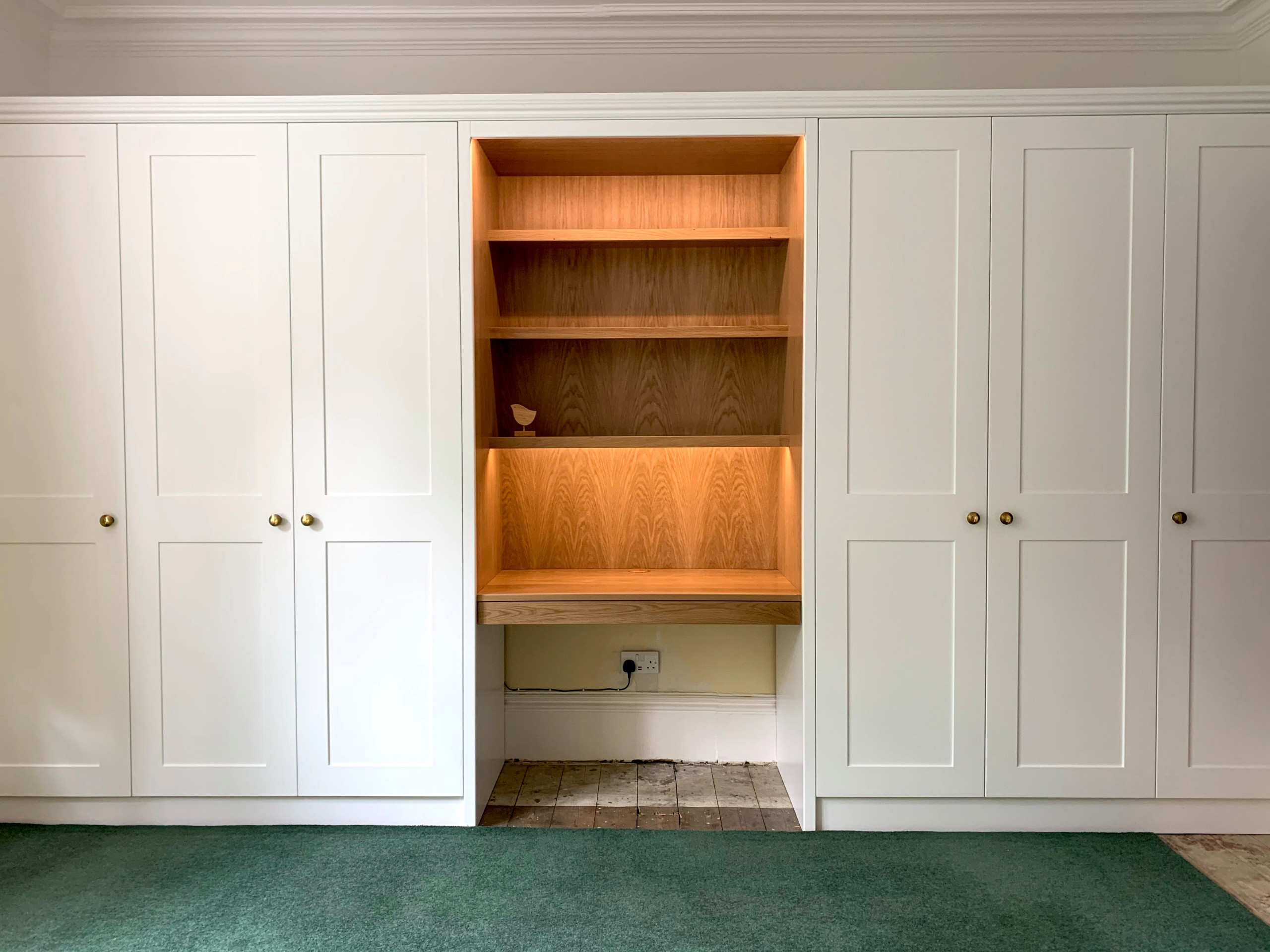 White shaker style wardrobes with oak desk section