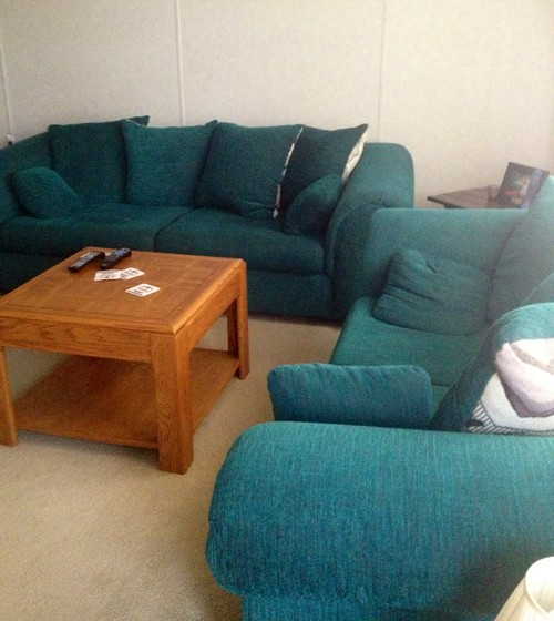 Dark Green Sofa: Does Purple And Blue Look Good With A Dark Green Couch?