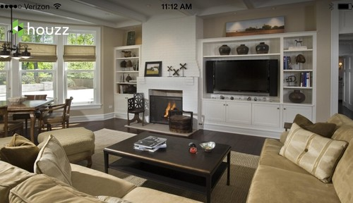 Where to put fireplace on same wall next to TV