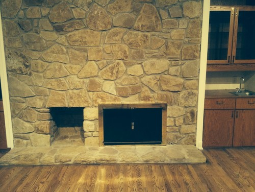 old stone fireplace. I don t know if a mantle would be good enough or need complete  resurfacing Our style is not modern Maybe something refurbished repurposed Old stone fireplace how can update