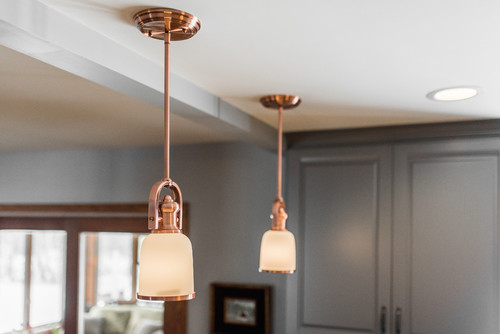 copper lighting fixtures in newly remodeled kitchen