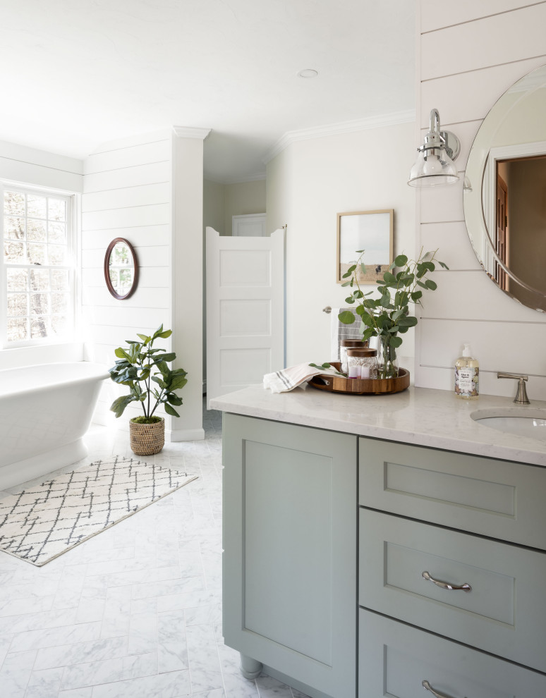 Large country master gray tile and porcelain tile porcelain tile, gray floor and double-sink bathroom photo in Boston with shaker cabinets, green cabinets, a two-piece toilet, white walls, a drop-in sink, quartz countertops, white countertops and a built-in vanity