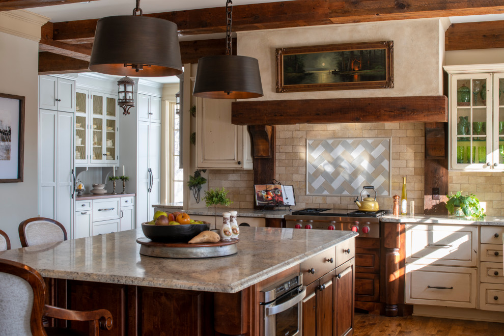 Inspiration for a large french country l-shaped medium tone wood floor, brown floor and exposed beam kitchen pantry remodel in Minneapolis with a farmhouse sink, recessed-panel cabinets, blue cabinets, granite countertops, beige backsplash, ceramic backsplash, stainless steel appliances, an island and beige countertops