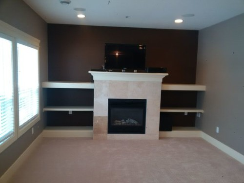We want to be able to put our tv on top of the mantel on a bracket so it lowers down over the fireplace...however the mantel is not flush with the wall