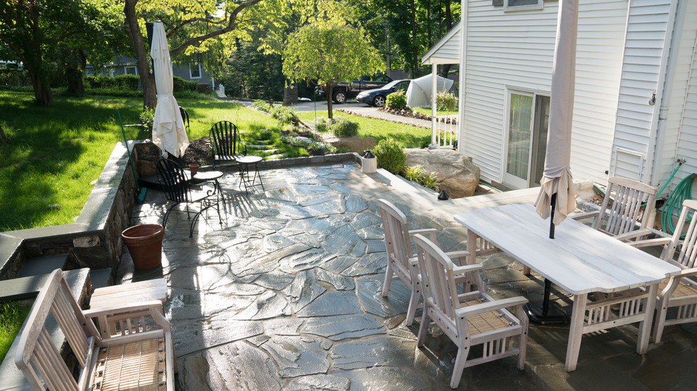 Flagstone patio with Fieldstone wall