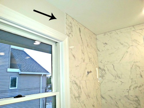 How to finish where the shower tile meets the wall?