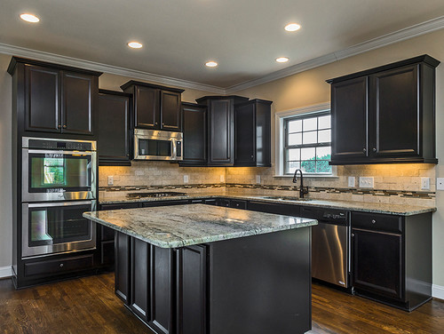 White kitchen or dark kitchen cabinets which do you prefer for Dark blue kitchen paint