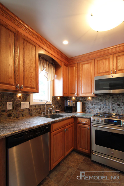 Stainless Appliances And Hardware With Oak Cabinets
