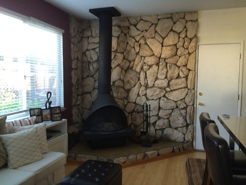 Removal of 1970s faux rock lava stone wall behind fireplace What do we call a picture painted on a wall