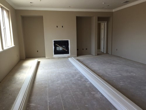 Tile around fireplace from floor to ceiling.