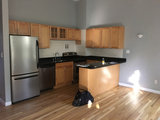 Two-Tone Cabinets and an Open Wood Island in a Sunny Kitchen (6 photos)