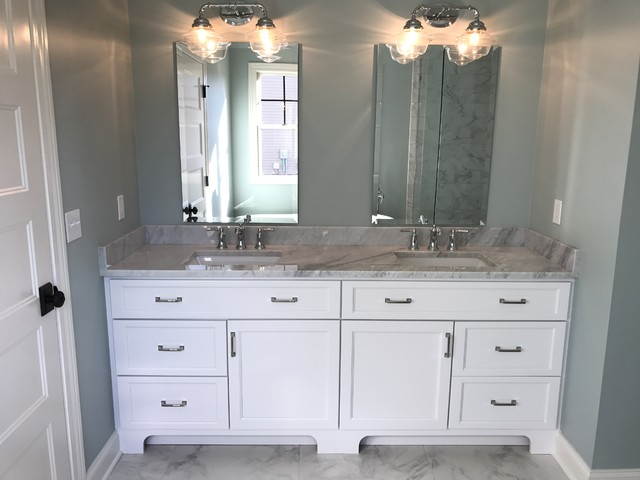 Example of a large trendy master porcelain floor and gray floor bathroom design in Cleveland with shaker cabinets, white cabinets, gray walls, an undermount sink and marble countertops