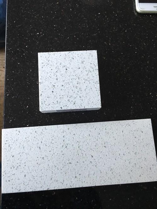 Mixing granite and quartz worktops /island