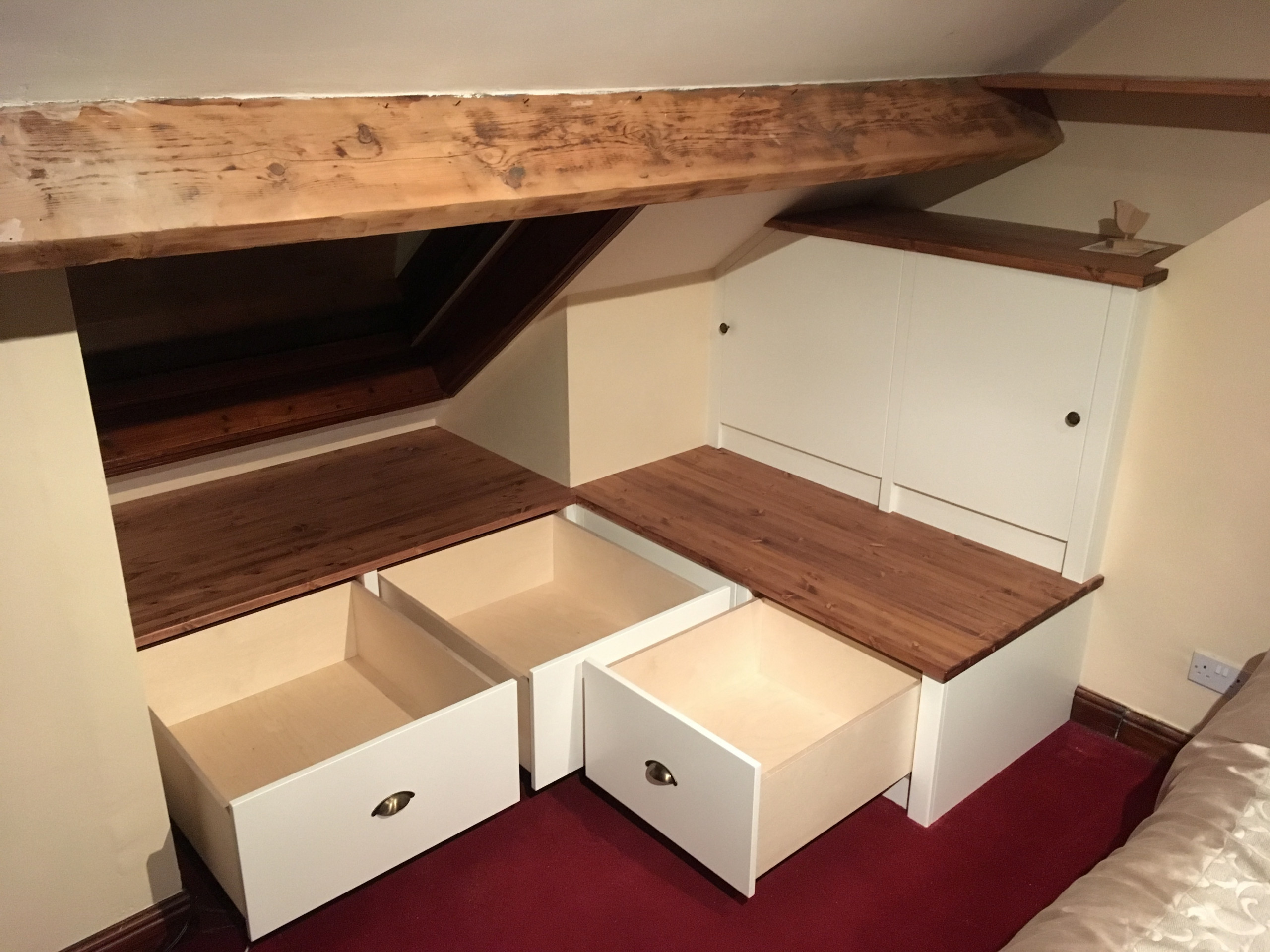 Very bespoke problem solving storage for am unusual attic space.
