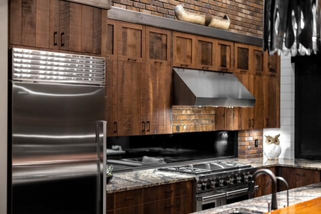 Kitchen - industrial kitchen idea in Other