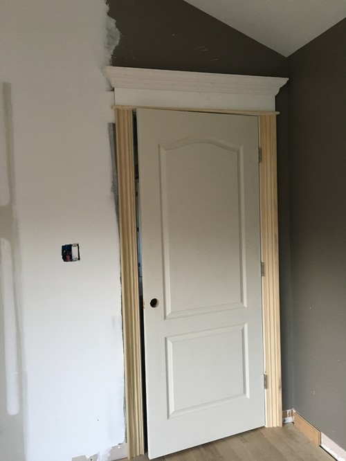 This is the view from inside the bedroom where the ceilings are higher & Oh NO!! This door molding is too big! What can I do??