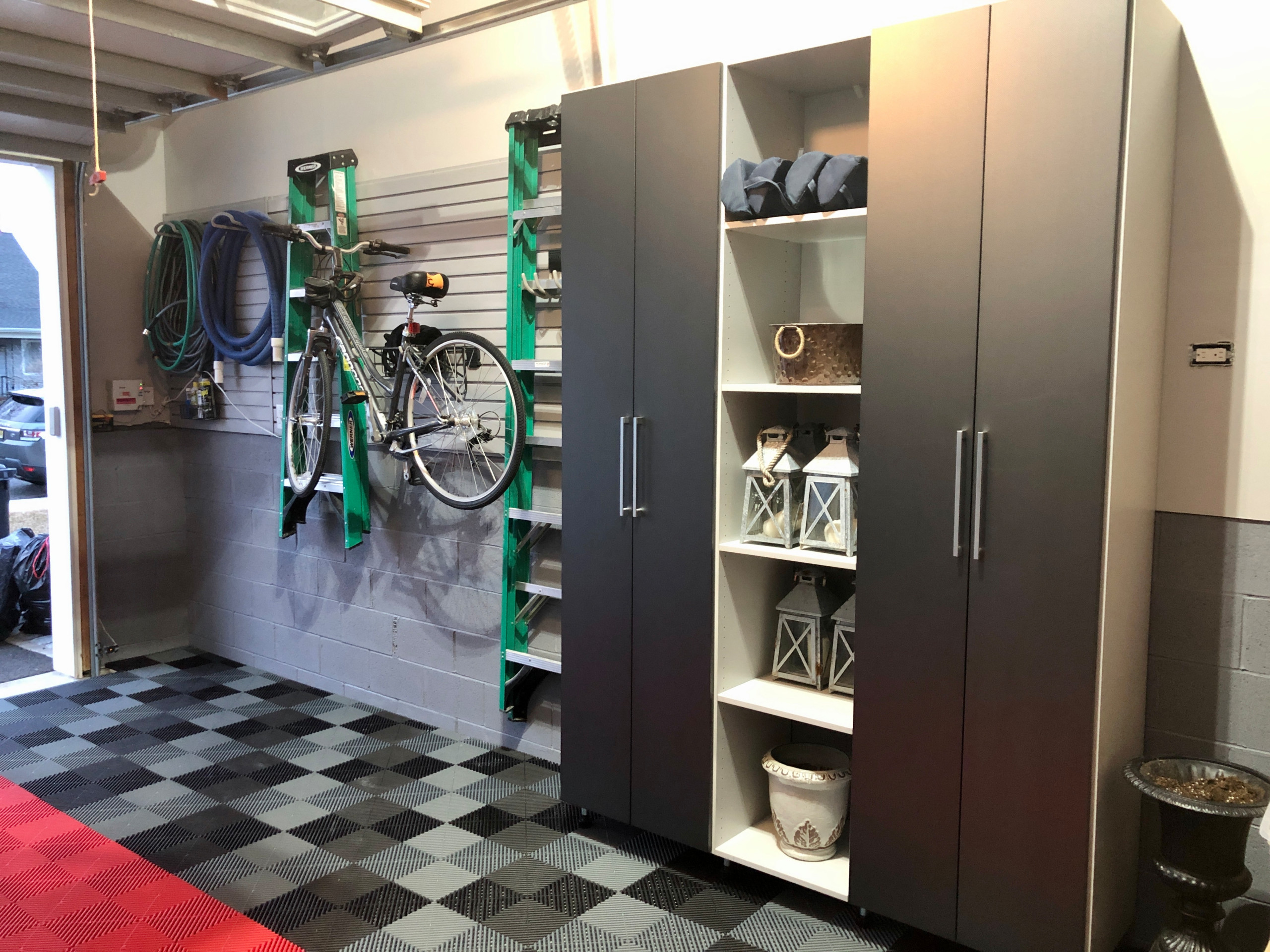 Example of a trendy garage design in Philadelphia with Swiss Traxx floor and slat wall