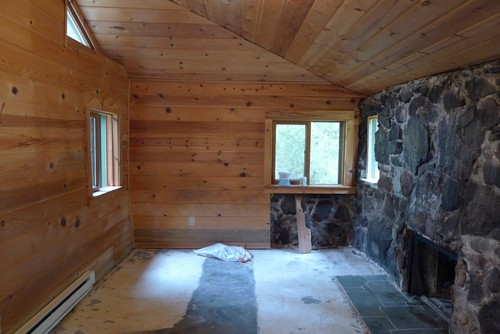 Help brightening a dark room in vacation cabin for How to use mirrors to brighten a room