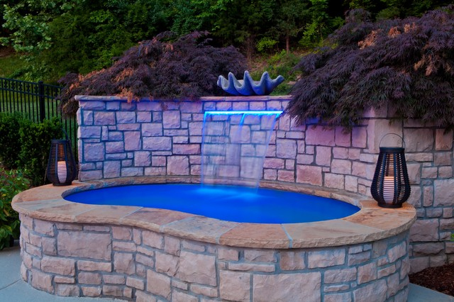 Custom Spa With Waterfall And Planter Wall Above The Spa