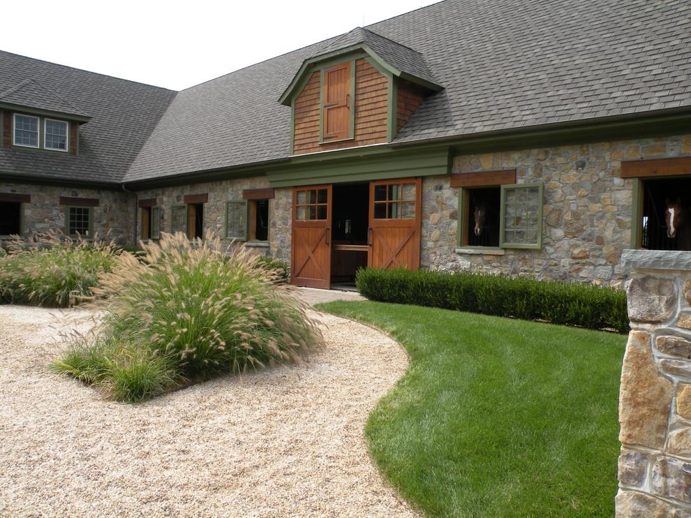 Example of a farmhouse home design design in Philadelphia