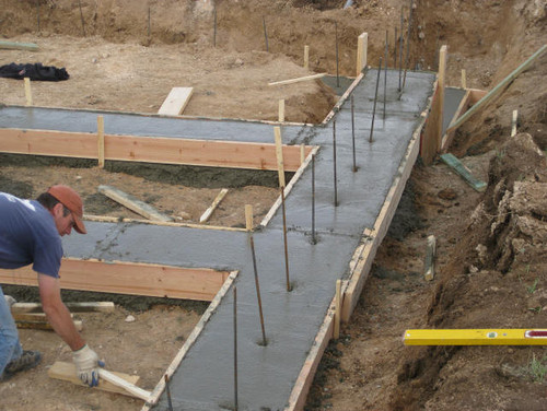 Best practice to insert rebars in concrete footer for Cost of poured concrete foundation walls