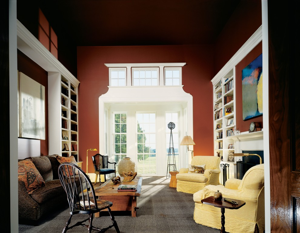 Living room library - farmhouse living room library idea in Richmond with red walls