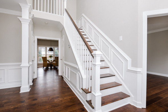 Example of a transitional home design design in Charlotte