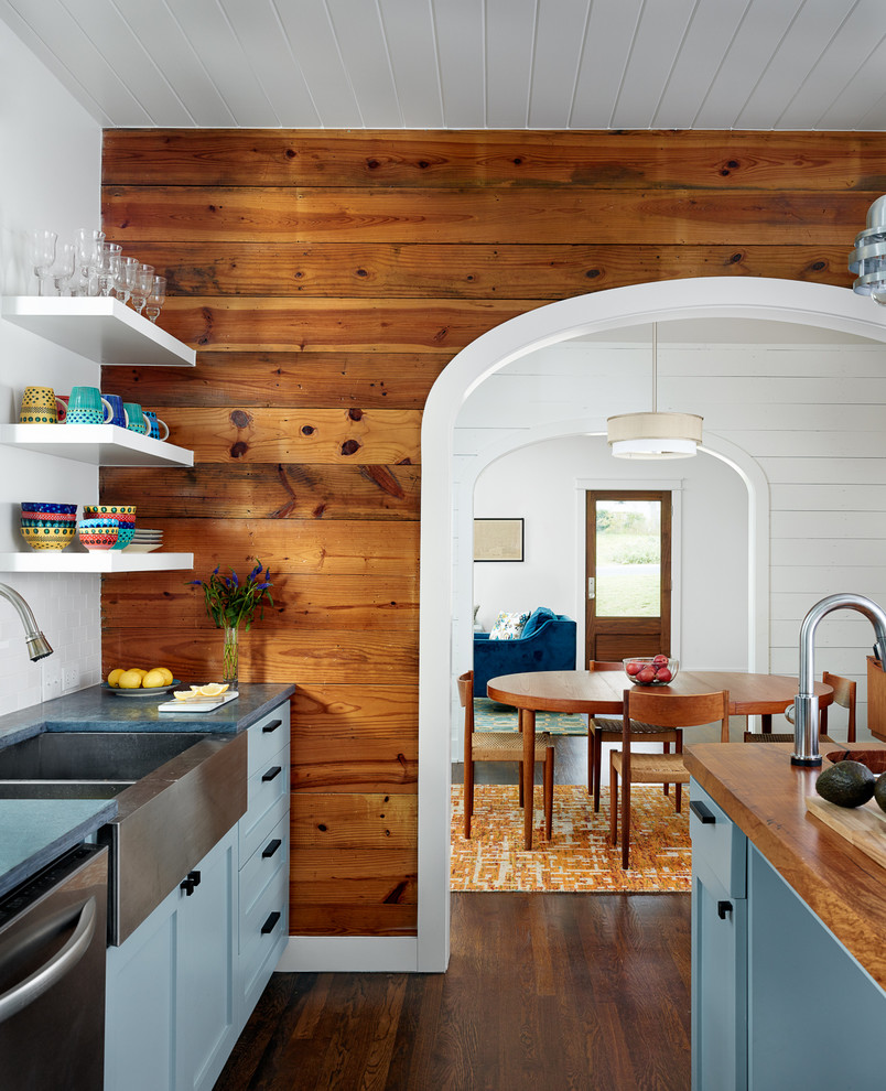 Enclosed kitchen - farmhouse enclosed kitchen idea in Austin with a farmhouse sink, shaker cabinets, blue cabinets, wood countertops, white backsplash and stainless steel appliances