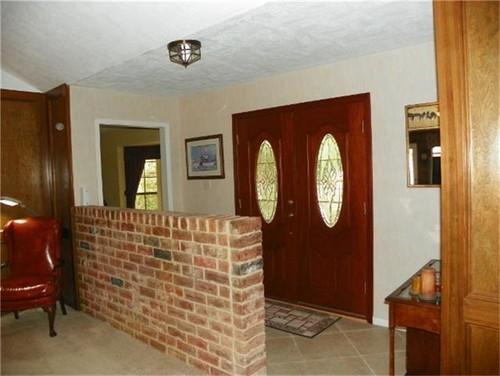 Strange Half Brick Wall In Entryway