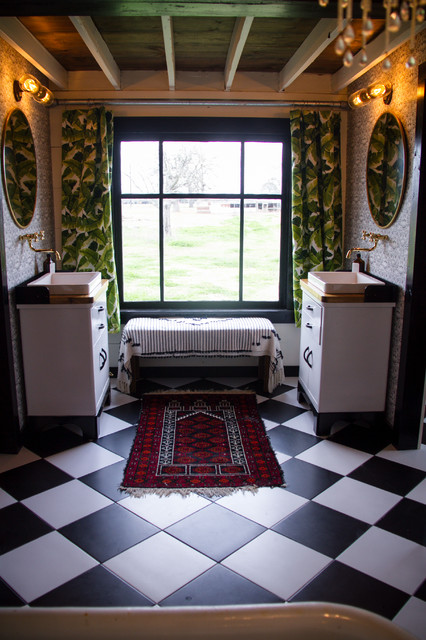 Example of a large farmhouse master black and white tile and ceramic tile ceramic floor and black floor bathroom design in Austin with furniture-like cabinets, a one-piece toilet, pink walls, a vessel sink, wood countertops and brown countertops