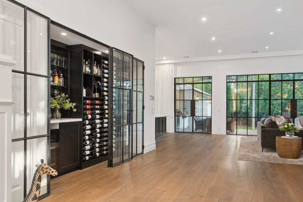 Large transitional wine cellar in Melbourne.