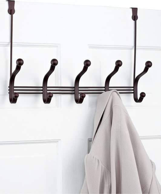 Over the door rack with hooks hold a variety of coat closet items.