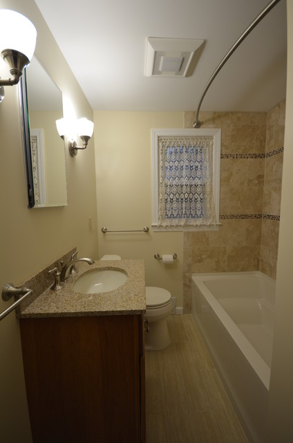 Small elegant beige tile and cement tile porcelain floor alcove bathtub photo in Other with an undermount sink, shaker cabinets, medium tone wood cabinets, granite countertops, a two-piece toilet and white walls
