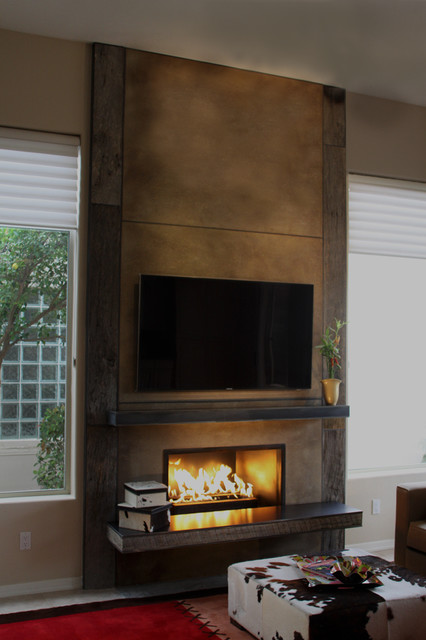 Fireplace using barn wood from porter barn wood concrete for Contemporary wood fireplace