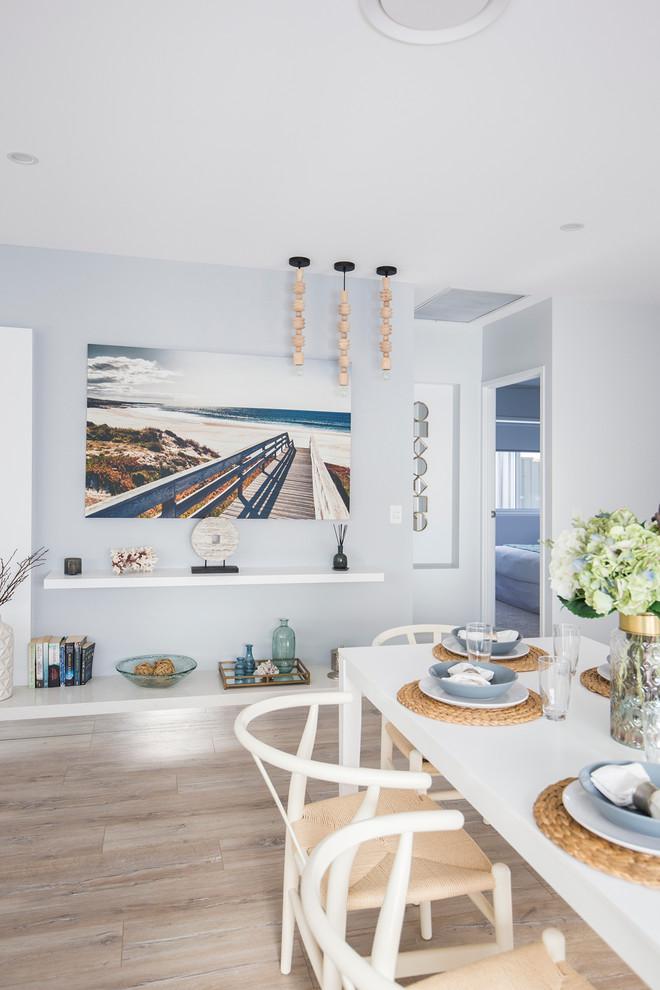 Beach style home design photo in Brisbane