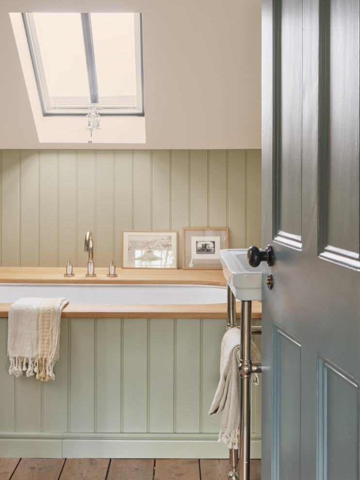 Medium sized traditional family bathroom in London with flat-panel cabinets, a built-in bath, a corner shower, a wall mounted toilet, multi-coloured walls, medium hardwood flooring, a pedestal sink, a sliding door, a wall niche, a single sink, a freestanding vanity unit and tongue and groove walls.