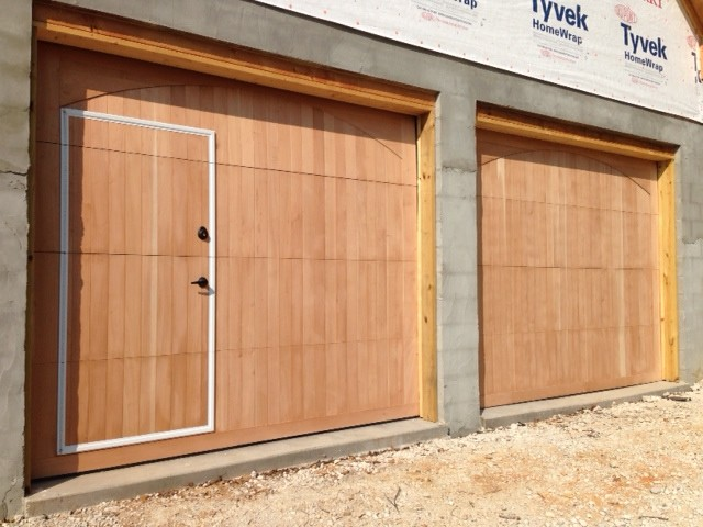 Custom wood face walkthru garage doors rustic garage for Rustic wood garage doors