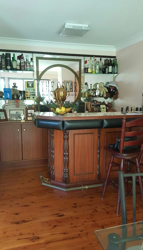 Bar Room Converted To Dinning Area With Hidden Storage Features