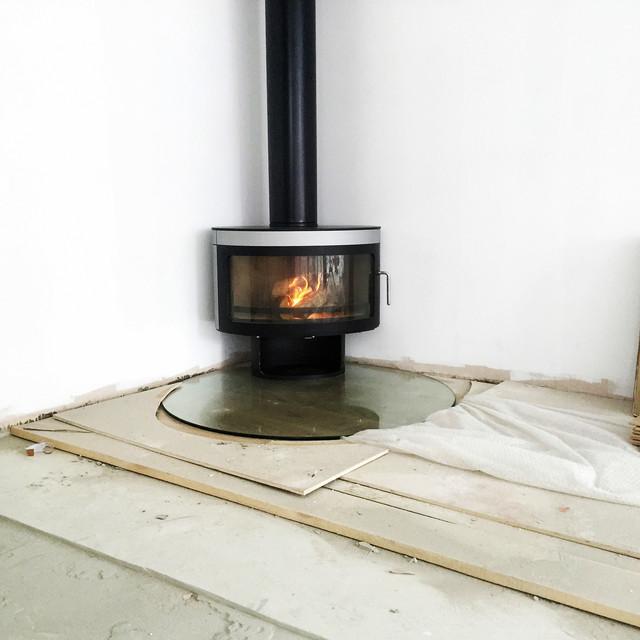 Panoramic fx1 wood burning stove contemporary wood burning stoves london by stoake - Contemporary wood furniture burning fireplaces ...
