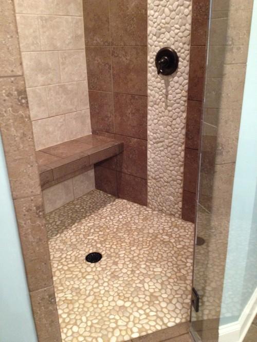 Tile shower floor leaking- advice please