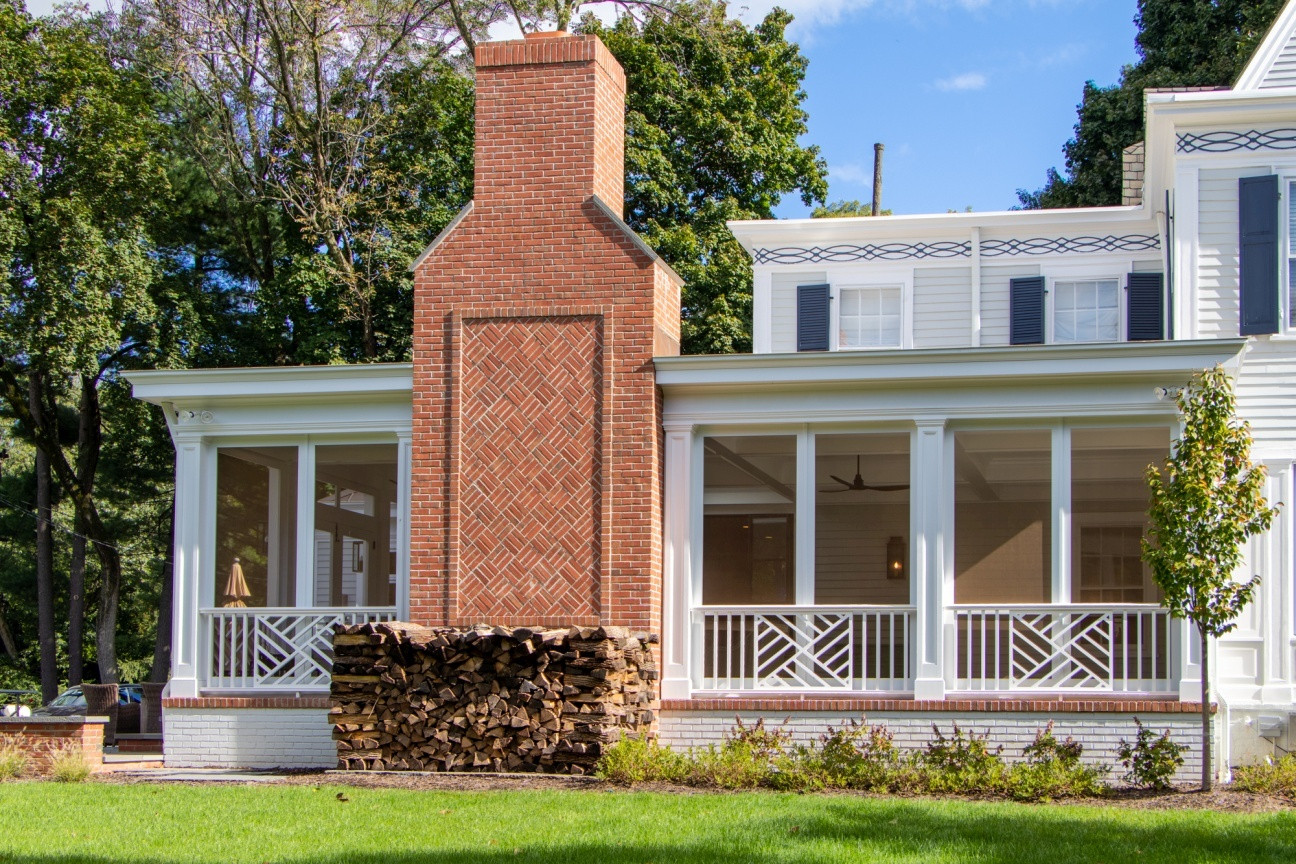 Screened porch with fireplace addition