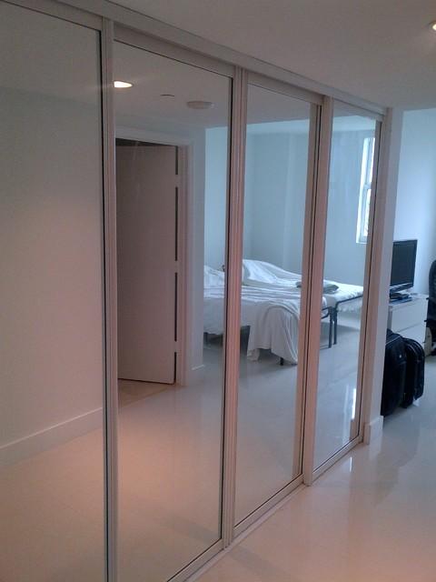 sliding doors contemporary bedroom miami by metro door usa. Black Bedroom Furniture Sets. Home Design Ideas