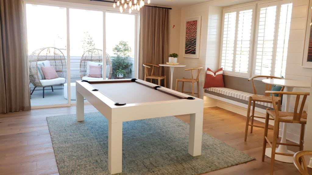 Modern pool table for staging in a beachfront model home