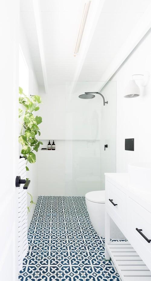 coastal bathroom with navy pattern floor tile