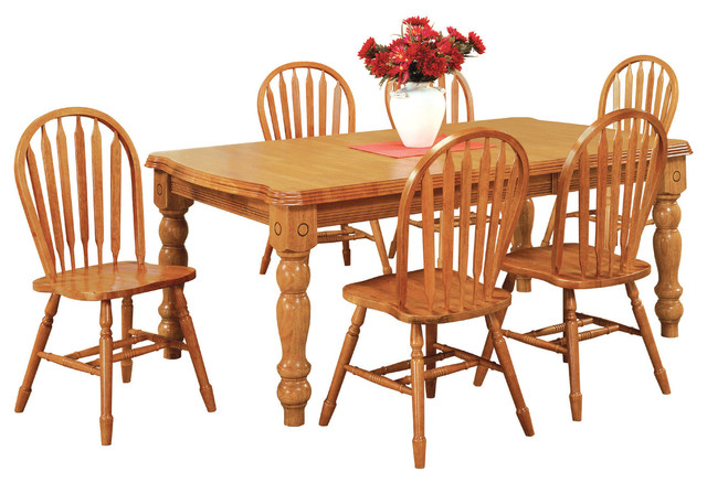 7-Piece Extension Dining Set With Arrowback Chairs.