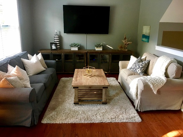 Inspiration for a mid-sized transitional loft-style medium tone wood floor and brown floor living room remodel in Charlotte with gray walls and a wall-mounted tv