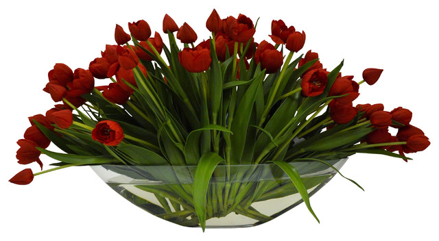 Red Tulips In A Gl Boat Vase