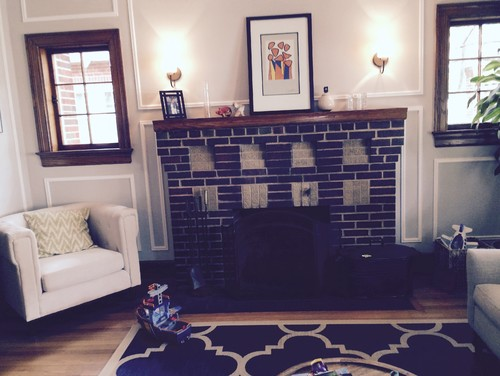 Brick fireplace with red tile hearth