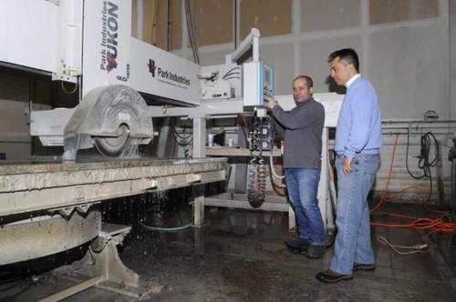 Our team cutting a slab of granite